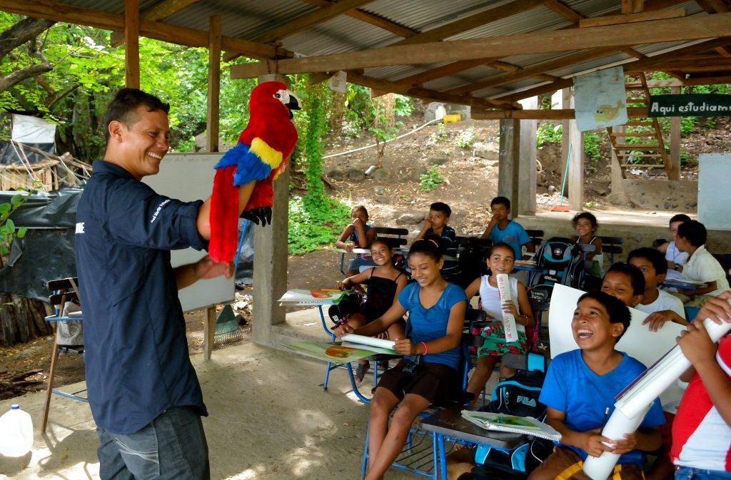 Macaito, the Cyanoptera Macaw, teaches children in the Cosiguina area